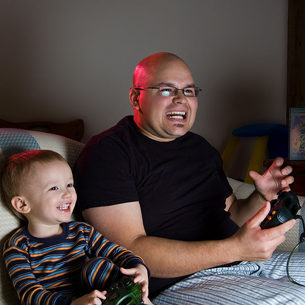 Dad getting beat at Xbox