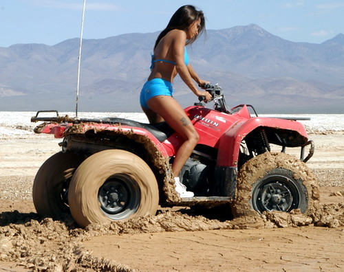 Girl on quad in mud