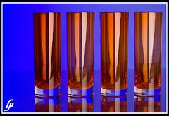 Glasses (fensterbme) Tags: blue orange glasses interestingness highcontrast columbusohio 5d canon100mmf28macro productphotography 100mmf28 fensterbme photographyclassproject 100mmf28macro interestingness128 i500 boldcolor tabletopstudio strobist canonef100mmf28macro explore28jan08