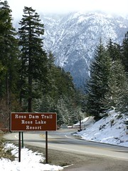 Trailhead, closed Hwy and mountains with spring snow