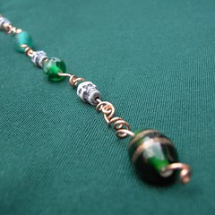 Green skully beaded window dangle