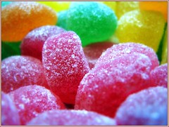 The pink ones are the best.... (Mary Trebilco) Tags: pink orange macro green yellow jellies sugar explore sweets jelly edible lollies canonpowershots3is hppt prettypinktuesday nahhhjustsomeofthem iknowtheyarecosiatethemafteriphotographedthem