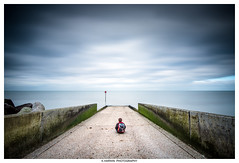 -------/ * \------- (Kevin HARWIN) Tags: water sea silk long exposure wall person boy male blue sky clouds green canon eos 70d sigma 1020mm lens herne bay south east kent england uk britain