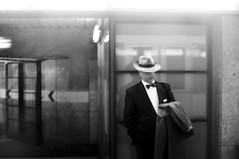 Man Out Of Time (Diana Pappas) Tags: barcelona man hat train subway spain platform bowtie espana someone exit timeless dapper overcoat welldressed