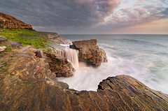 Waterfalls and Waves, part II (Joshua Cripps) Tags: ocean california santa pink sunset sea seascape color clouds america coast waterfall nikon rocks long exposure waves purple pacific joshua tokina cruz cave davenport cascade 1224 cripps d300s