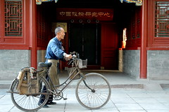 Poor & Rich (Luo Shaoyang) Tags: china nikon politics rich poor chinese bikes economic  communistparty richandpoor poorer supershot politicalsystem golddragon anawesomeshot luoshaoyang