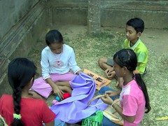 a group of children make hand creativity in semarapura monument area.