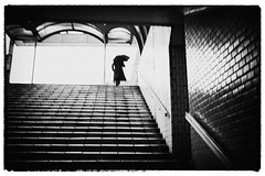 gloomy (tomorca) Tags: silhouette woman stairs umbrella street bw monochrome t