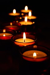 Turn off the light (Sandrine 87) Tags: light red orange rouge fire candles bokeh lumire bec flamme bougies pleasant thebigone loupiotes 10faves creativephoto passionphotography mywinners flickrhearts superhearts