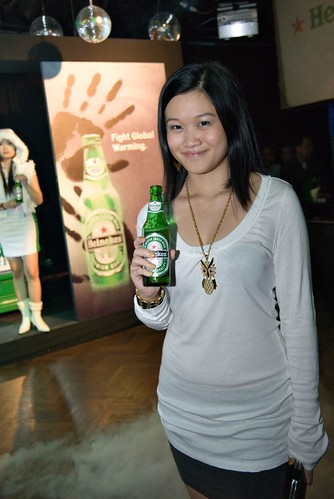 Kimberlycun with Heineken Extra Cold Beer.