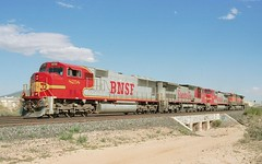 BNSF EMD SD-75M 8258 and 3 GE mates (Numbers 850 and 936, both C40-8W, and 1074, a C44-9W)) in Tucson, Arizona, 1999, after pulling a coal train over the Union Pacific to the Tucson Electric Power generating plant near Davis Monthan Air Force Base. (Ivan S. Abrams) Tags: california arizona santafe up minnesota electric nebraska diesel tucson nevada ivan trains sierra amtrak sp flagstaff fresno getty unionpacific freighttrains reno clovis abrams ge railways tehachapi bnsf belen locomotives cajon gettyimages railroads abo generalelectric southernpacific willmar smrgsbord tucsonarizona uprr atsf warbonnet riordan cnw ferromex chicagoandnorthwestern eriepennsylvania railfans 12608 diesellocomotives sd70i santaferailway onlythebestare dieselelectriclocomotives ivansabrams trainplanepro arizonatrains pimacountyarizona safyan arizonabar spdaylight arizonaphotographers ivanabrams cochisecountyarizona widecabs tucson3985 getransportationsystems gettyimagesandtheflickrcollection copyrightivansabramsallrightsreservedunauthorizeduseofthisimageisprohibited tucson3985gmailcom ivansafyanabrams arizonalawyers statebarofarizona californialawyers califiorniazephyr abramsandmcdanielinternationallawandeconomicdiplomacy