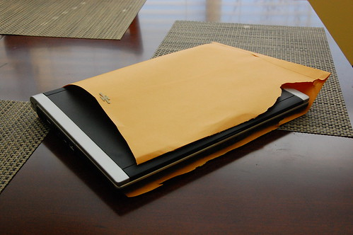 A Dell laptop, shoved unceremoniously into a manila folder.