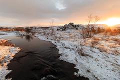 Finally some sun (GummiG!) Tags: iceland snow creek canon wideangle lava sun