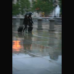 two in the rain ... [4] (_nejire_) Tags: light england macro reflection london wet rain umbrella canon eos kiss bokeh streetphotography trafalgarsquare explore f28 streetshot canonefs60mmmacro 10faves nejire 400d 415pm eos400d canoneos400d kissx fave10 mhashi 4112253g1040pm 6619375g10pm