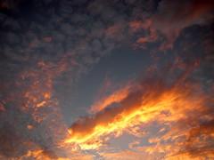 burst (piikapii) Tags: blue sunset sky orange cloud wow dynamic puff burst