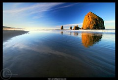 Cannon Beach's Sunrise (Arnold Pouteau's) Tags: sea reflection oregon sunrise coast pacific cannonbeach haystackrock soe kac supershot golddragon mywinners cmeradeourobrasil landscapesdreams fland10