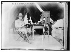 Col. A.C. Sharpe, Camp Perry  (LOC) (The Library of Congress) Tags: ohio camp usa america vintage soldier army reading us belt uniform gun sitting unitedstates desk military tent pistol sword leader libraryofcongress bullet 1910s colonel perry ammunition weapons holster sharpe ottawacounty campperry xmlns:dc=httppurlorgdcelements11 officeinabox dc:identifier=httphdllocgovlocpnpggbain09476 acsharpe