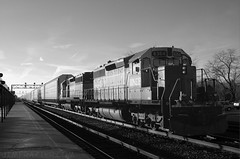 BNSF 6364 Waiting in Naperville (Jim Frazier) Tags: railroad blackandwhite bw santafe industry monochrome metal train vanishingpoint illinois shiny industrial december commerce glare technology power metallic machine engineering railway dupage manipulation il equipment business machinery amtrak commercial engines infrastructure strong locomotive desaturated metra naperville mighty powerful complex railfan bnsf wedge apparatus locomotives glint wedgie 2007 complicated might rightofway mercantile burlingtonnorthern bwset atsf railfanning burlingtonnorthernsantafe dupagecounty threequarterview q4 34view trainwatching smokingwedge smokingwedgie