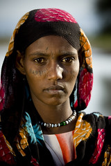 Afambo afar girl Ethiopia (Eric Lafforgue) Tags: africa portrait woman girl beauty face tattoo female day african femme culture tribal tattoos explore beautifulwoman ethiopia tribe tatoo fille voile beautifulpeople scars adultsonly scarification visage tatuaje headdress 1107 afrique headwear headgear ethiopian afar nomade eastafrica ethiopie colorimage scarifications tribalgirl lafforgue danakil dankali 1people africanculture betterthangood afambo tribalgirls asaita dancalia assayta nomadiclifeafricavienomade africantribalculture