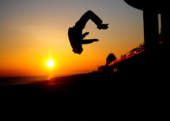 Flying Into Freedom (tezzr) Tags: sunset freedom silhouettes freerunning parkour backflip bottlealley nikond300 chpe08 chpb09 chpb09yh