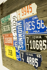 Iowa Plates (aplseed photography) Tags: hinge wall vintage state iowa multicolored shape licenseplates desmoines barnboard autosalvage rustnailheads