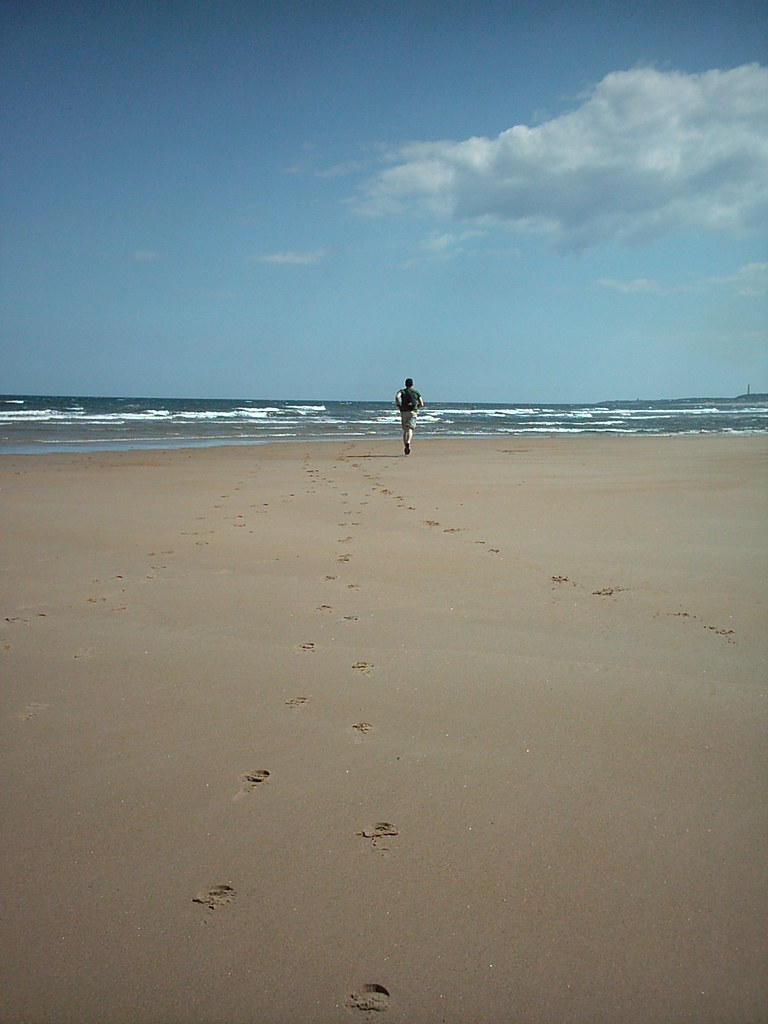 Glen running on Druridge Bay Beach - Cresswell, Northumberland