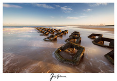 Morning glow (jaygilmour11) Tags: water ocean sea seascape groynes groins seadefence longexposure sky blue yellow orange waves leefilters colours colors landscape morning glow vivid sand rocks newbrighton liverpool merseyside