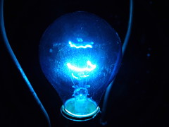 051 blue transmission (Praxis Transmutation) Tags: macro closeup night nightlights nightlife midnight bored light lightbulb electricity electric spark glass old lamp san california dust industrial indoors house household panasonic glow tint blue