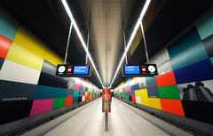 Inside The Space Station (Philipp Klinger Photography) Tags: city pink blue light shadow red white black color colour reflection green clock colors lines station sign yellow wall architecture modern train booth germany subway munich mnchen bayern deutschland bavaria nikon europe track colours phone angle metro teal wide platform vivid tunnel symmetry ceiling line ring ubahn rails walls sos emergency philipp georg klinger georgbrauchlering brauchle colorphotoaward d700 vanagram