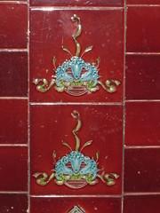 Late Victorian Art Nouveau Shop Front Tiles of Blue Lilies - Pin Oak Crescent, Flemington (raaen99) Tags: flowers blue red floral shop architecture tile ceramic design three petals flora ribbons lily architecturaldetail victorian australia melbourne victoria garland petal artnouveau lilies pottery ribbon bouquet nouveau porcelain feature shopfront flemington edwardian glazed crazed stylised architecturalfeature majollica pinoakcrescent pinoakcres