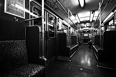 Almost Empty Subway (Gregor Winter) Tags: street city nyc winter people blackandwhite bw woman white distortion ny man black berlin male blanco monochrome station female contrast train canon germany dark underground subway wagon point person 350d waiting europe mood alone sitting metro body candid empty seat negro grain deep streetphotography documentary sigma bank wideangle shaddow highlights db bn streik human seats ubahn limbs moment noise knee vanishing bahn gregor deutsche vanish 10mm weis sitze schwarze abteil 123bw emptieness wagong subwaymoment