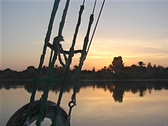 Nile Sunrise (Marco Di Fabio) Tags: travel trees plants sun sol water grass rio alberi backlight sunrise river contraluz gold golden boat agua plantas barca barco mud riva alba fiume egypt bank ground nile erba amanecer clay momento shore land egipto moment sole terra acqua prato memento egitto controluce dorado oro orilla tierra ribera hierba nilo feluca dorato arbores abigfave lpmorning lawnpiante