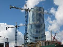 Miami, ca. Early 21st Century (Hialean) Tags: construction downtown day realestate symbol florida crane miami sunny bluesky boom fl constructioncranes dwntwn southflorida bankofamericatower downtownmiami buildingboom