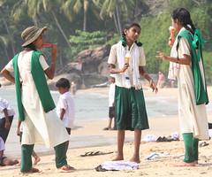 IMG_5080 - Ice cream girls (HAKANU) Tags: sea india beach water uniform wave kerala icecream schoolchildren bathing schoolkids attheseaside breakwater kovalam arabiansea bythesea