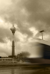 Iran, Tehran, Milad Tower (Hamed Saber) Tags: motion reflection building tower rain sepia clouds truck highway iran tehran  milad miladtower    hemmat