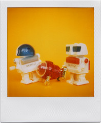 Schoolyard Bullies (tubes.) Tags: school film playground polaroid sx70 toys robot robots 600 windup bully tomy bullies schooldays