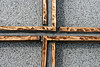 cross detail (Leo Reynolds) Tags: cemetery cemeterypassy cross impossibleflag leol30random groupgraves groupozy canon eos 30d 0004sec f9 iso100 60mm 0ev onecross grouputata xleol30x hpexif xratio3x2x grouppariscemeteries xx2008xx