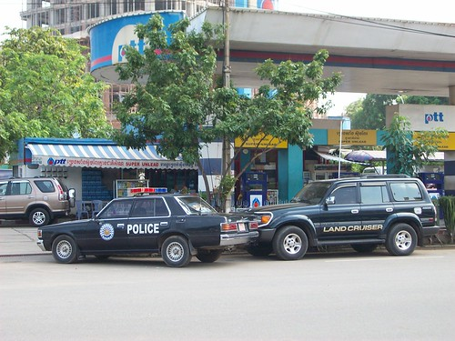 Police car and land cruiser