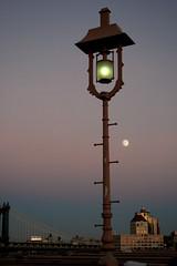 Bridge Lamp (varonbc) Tags: newyorkcity blue light sky urban orange moon reflection monument night outside outdoors streetlamp noflash brooklynbridge farol nightlamp urbanphotography brightmoon brooklynsunset eveningshot outdoorphotography brooklynriver brigecables