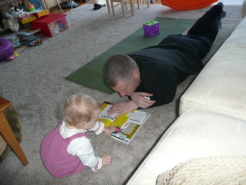 Ella, showing daddy an article in scientific american