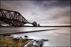 Hightide @ the Red Bridge (angus clyne) Tags: road longexposure bridge red sea cloud storm beach wet water grass rain ferry train mouth river grey coast scotland pier boat weed edinburgh long exposure paint flat wind fife jetty north scottish wave bank rail stormy tunnel calm east queens forth filter shore sail span firth greay forthrailwaybridge colorphotoaward