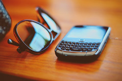 (Emma) Tags: sun reflection sunglasses bag table 50mm keyboard blackberry sunny curve tones bbm rayban dkny d5000