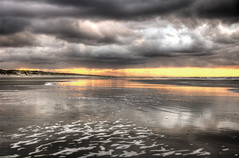 Ameland (Danil) Tags: light sunset sky reflection beach dutch clouds strand dark golf landscape gold waddeneiland zonsondergang nikon view wind dune d70s noordzee wolken wave foam ameland effect duinen vuurtoren meeuw hdr branding schuim donker eiland herst goud golven photomatix flickrsbest anawesomeshot