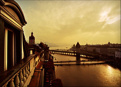 From the Other Side of the Window (Katarina 2353) Tags: morning bridge autumn windows light sky panorama orange lake building tower film water beautiful clouds sunrise photography dawn golden schweiz switzerland nikon europe flickr shadows suisse image swiss magic luzern cielo views lucerne wasserturm luzerne chapelbridge kapellbrcke reuss arhitecture katarinastefanovic katarina2353