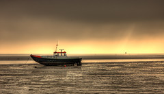 waiting for sea (Danil) Tags: ocean light sunset sea sky sun holland bird water beautiful waddenzee wow landscape boot gold waddeneiland amazing zonsondergang nikon ray view tide d70s nederland ameland nes boar friesland buren eb kust photomatix getijde pseudohdr anawesomeshot
