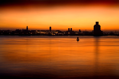 Birkenhead Skyline (BarneyF) Tags: longexposure sunset orange reflection building silhouette skyline river mersey 08 wirral merseyside livepool capitalofculture theperfectphotographer