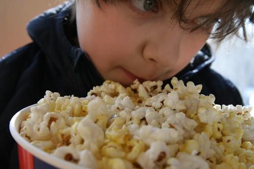 my boy, with popcorn
