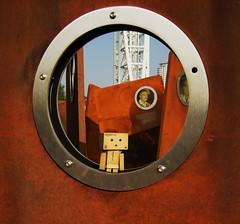 PORTHOLE DANBO (weasteman) Tags: bridge sculpture metal docks manchester toy amazon rust steel salfordquays quay bbc porthole weathered salford danbo manchestershipcanal amazoncojp nikonp50 weasteman nikonp50coolpix revoltechdanbo projectdanbo