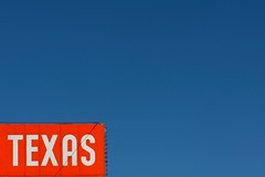 texas (xgray) Tags: street blue sky orange white sign digital upload canon austin eos prime texas 85mm rental iphoto guadalupe thedrag ef85mmf18 40d ziplens postedtophotographersonlj xgrayvision2007