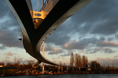 Nescio bridge - Amsterdam (kees straver (will be back online soon friends)) Tags: street city bridge blue light sky urban orange holland reflection water netherlands amsterdam bike bicycle architecture clouds buildings landscape boat canal europe nederland brug diemen ijburg amsterdamrijnkanaal architecturebuilding nesciobrug outstandingshots abigfave goldmedalwinner nesciobridge anawesomeshot superbmasterpiece flickrdiamond onlythebestare betterthangood goldstaraward keesstraver
